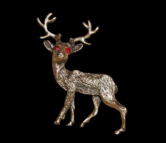 Deer brooch. Antiqued bronze tone metal, red rhinestones eyes. 1970s