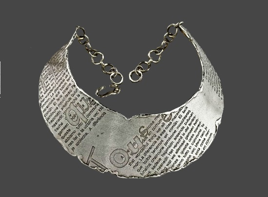 Designed for the Human Rights collection silver tone typographic necklace. 1990s