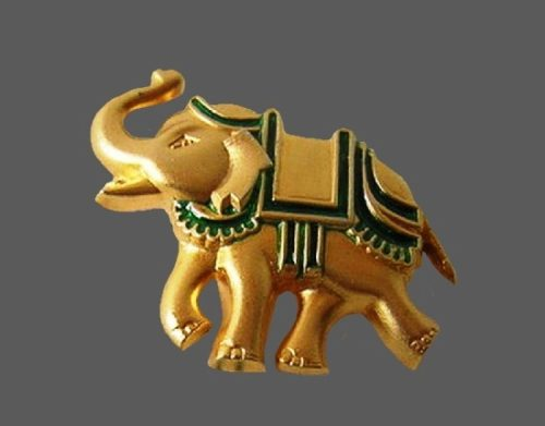 Elephant brooch from Indian Nights collection. Gold tone alloy, green enamel. 4 cm. 1980s