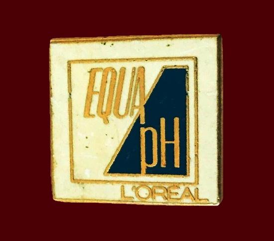 Equa ph advertising badge. Gold tone, enamel