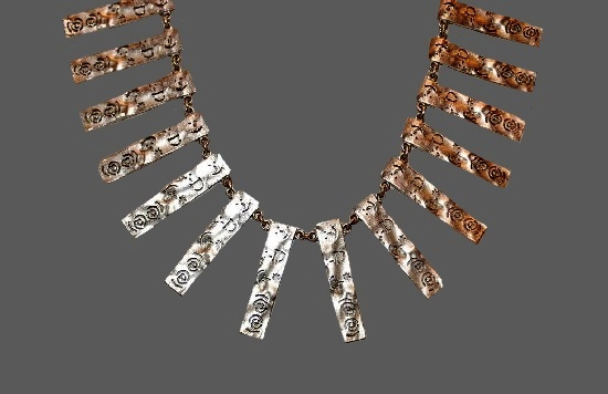 Ethnic style bib necklace. Textured silver