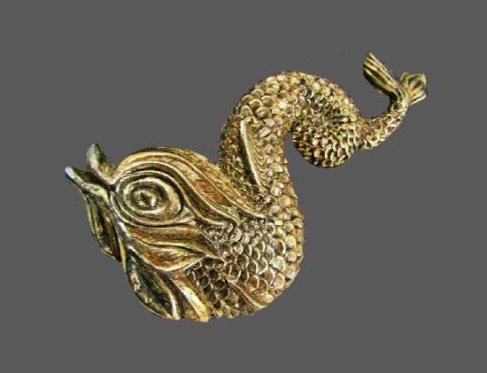 Exotic fish of antique gold tone textured metal