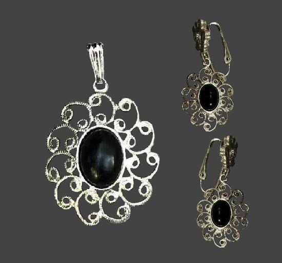 Filigree design flower pendant and dangling earrings. Silver tone metal, black plastic