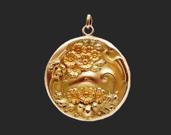 Floral design 14 K gold filled locket pendant. 1910s