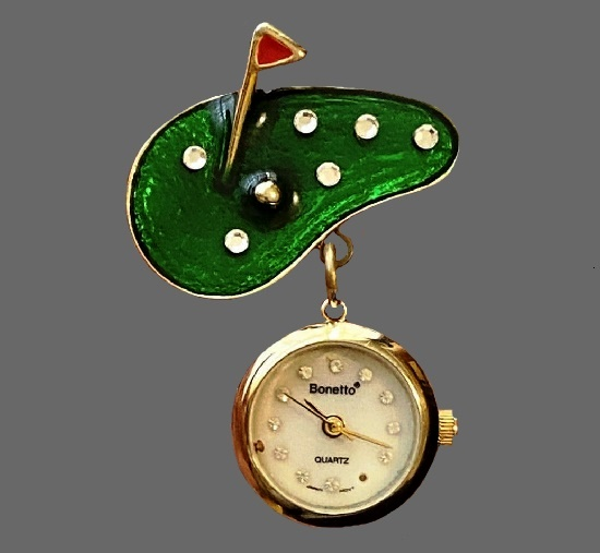 Green field gold flag brooch with watch