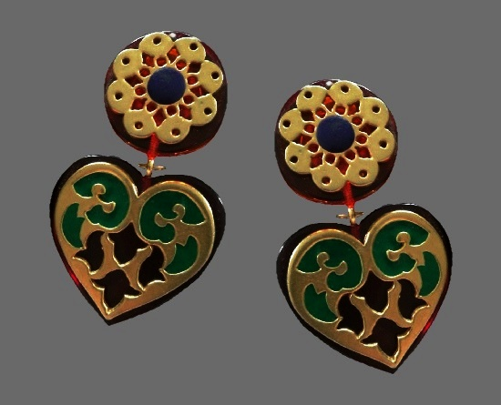 Haute couture statement earrings with dangling heart. Gold tone alloy, lucite, enamel