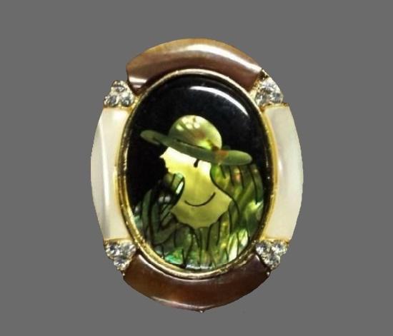 Lady in hat cameo brooch. Handpainted enamel, gold tone metal, rhinestones