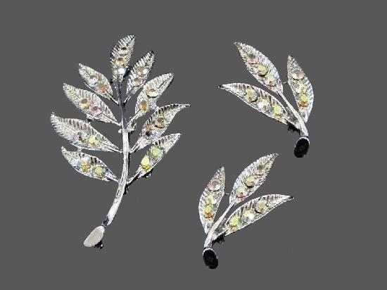Leaf design brooch and earrings. Silver tone, rhinestones