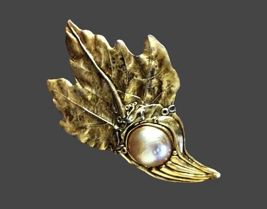 Leaf design brooch. Gold tone metal alloy, faux pearl