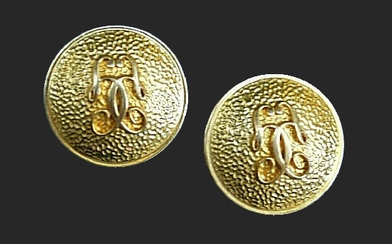 Logo round shaped gold tone textured metal clip on earrings. 3.5 cm