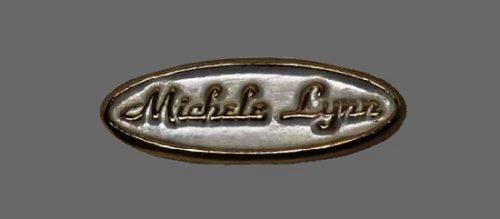 Michele Lynn oval shaped brooch. Brass, steel. 1980s