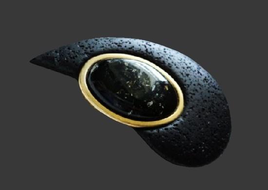 Modernist design brooch. Black resin, gold tone metal, plastic