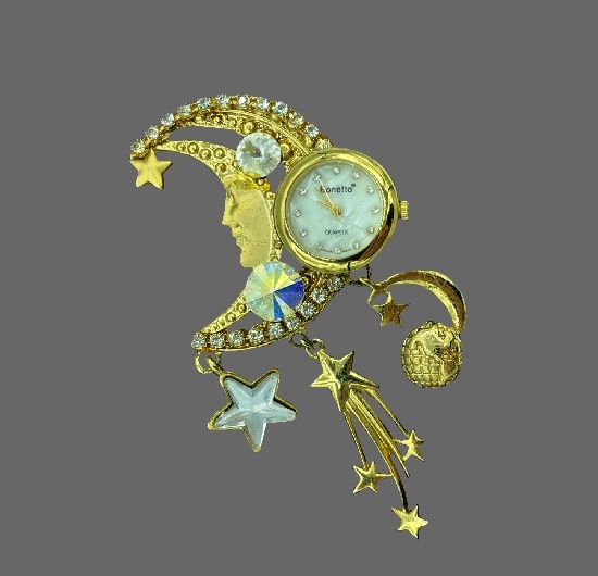 Moon and Stars brooch with watch and charms. Gold tone metal alloy, rhinestones, mother-of-pearl