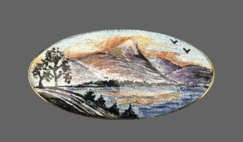 Mountain lake scenic design oval shaped brooch. Sterling silver, enamel