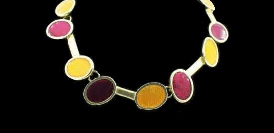 Multicolor enamel gold tone metal necklace. 1990s