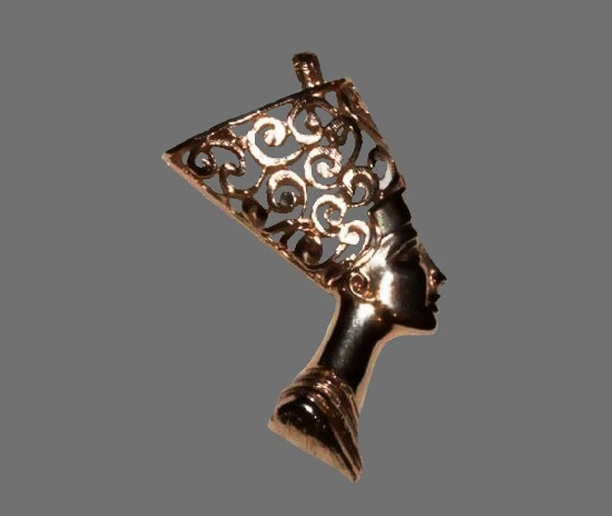 Nefertiti gold tone pendant. 1980s