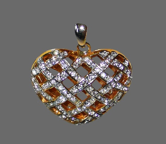 Openwork heart pendant. Gold tone metal, rhinestones. 1980s