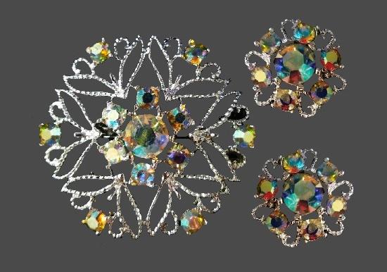 Ornamental design brooch and clip on earrings. Silver tone metal, Aurora borealis rhinestones. 1960s