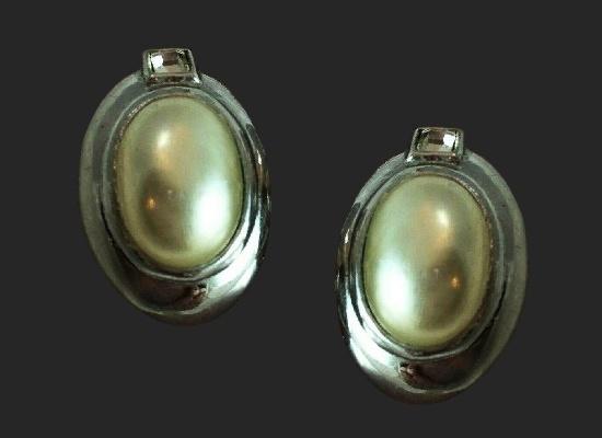 Oval shaped clip on earrings. Silver tone alloy, pearl cabochon, rhinestones. 2.4 cm. Jean Louis Scherrer