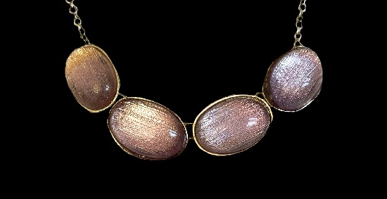 Oval shaped lucite brass necklace. 1990s