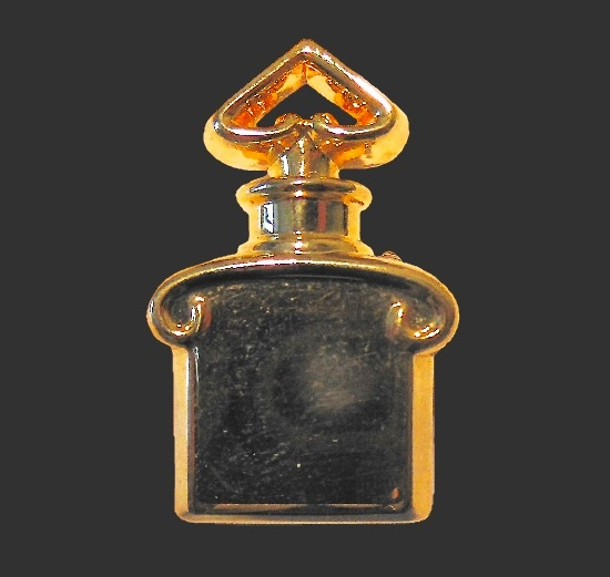 Pendant in the shape of perfume bottle of gold tone