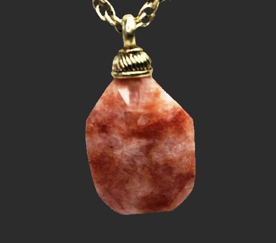 Rose quartz gold tone pendant