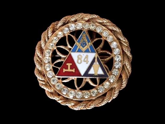 Round shaped Masonic brooch pendant. Gold tone metal, enamel, rhinestones. 1980s