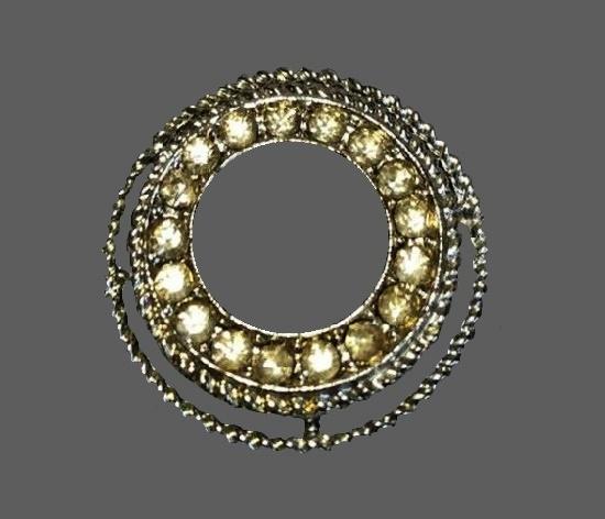 Round shaped silver tone rhinestones pin