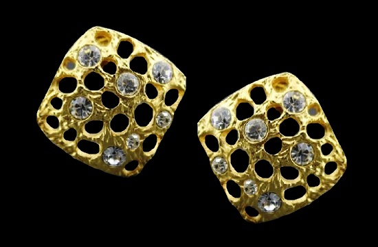 Square shaped surface with holes clip on earrings. Gold tone metal, crystals. 2.7 cm. 1980s