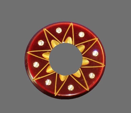 Star inside round circle brooch. Fold tone metal, rhinestones, plastic