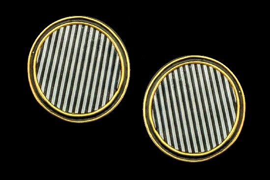 Striped round shaped clip on earrings. Gold tone metal, plastic
