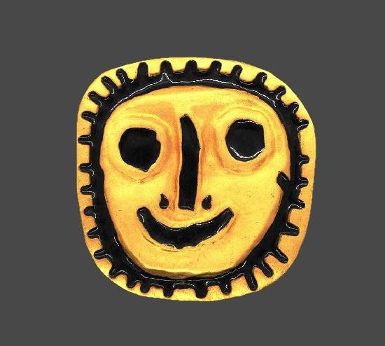Stylized sun face brooch. Gold tone metal, black enamel. 1980s