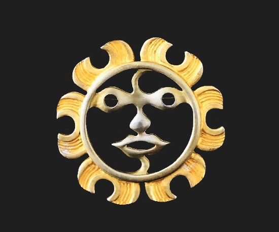 Sun brooch of gold and silver tone