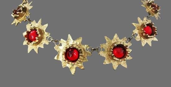 Sunburst design necklace. Gold plated metal alloy, art glass. 1980s