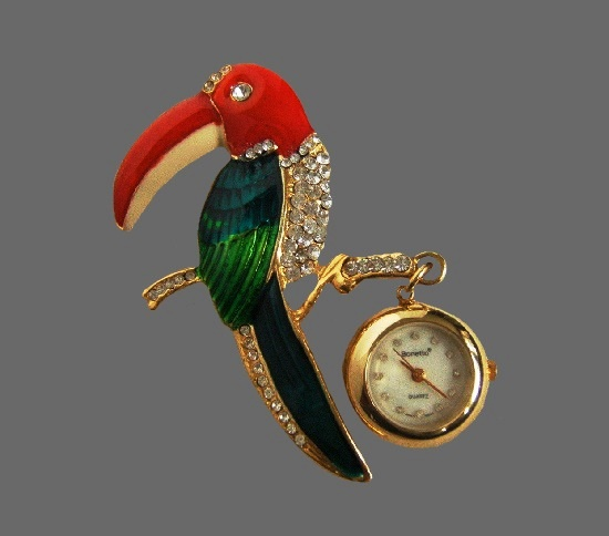 Toucan brooch with watches. Gold plated metal, enamel, crystals. 7 cm. 1980s
