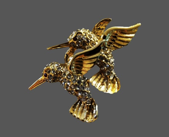 Two hummingbirds figural brooch. Gold tone, rhinestones, enamel