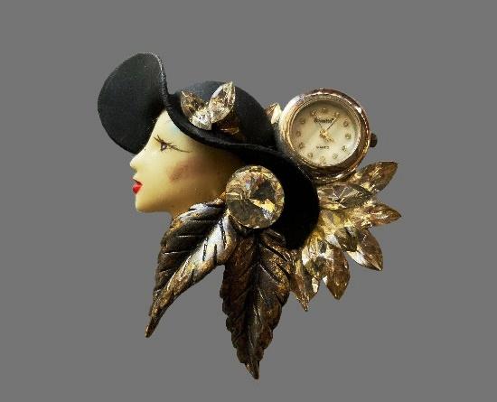 Woman in a black hat brooch with clock. Metal alloy, rhinestones, hand painted enamel, plastic. 1960s