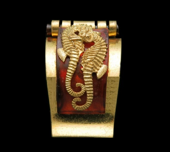 Amber color galalith seahorse design gold tone clip brooch. 1930s