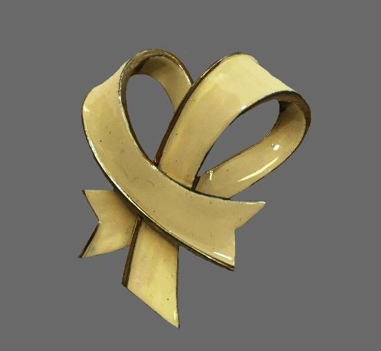 Beige enamel bow design brooch