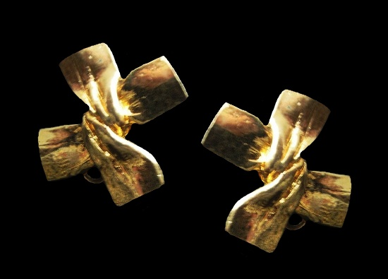 Bow design gold tone clip on earrings. 1980s