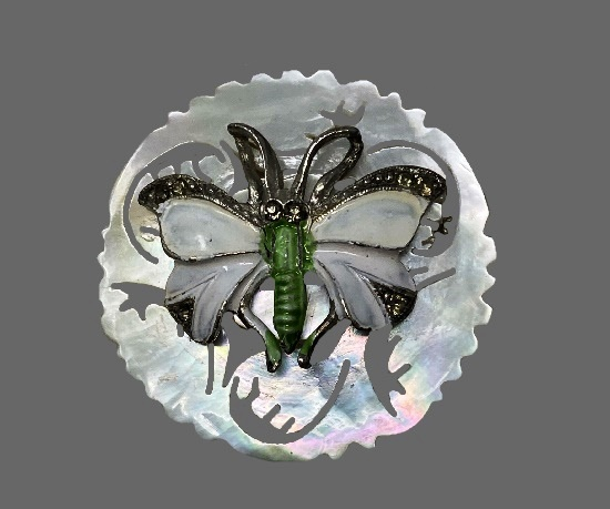 Butterfly round shaped brooch. Carved mother-of-pearl, rhinestones, enamel, lucite, sterling silver