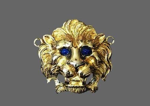 Lion head gold tone pendant. 6 cm