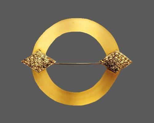Circle pin. Gold tone metal, lucite, rhinestones