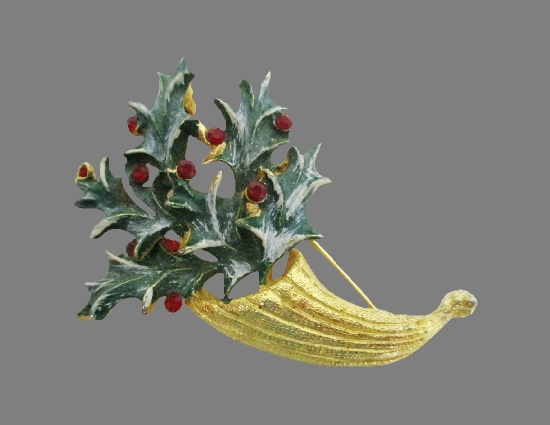 Cornucopia with holly leaves vintage brooch. Gold tone metal alloy, enamel, rhinestones