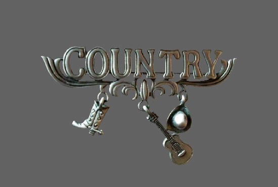 Country brooch with guitar, hat and boot charms. 1980s