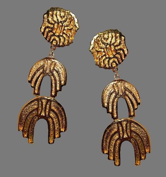 Etruscan design runway dangling clip earrings. Gold plated textured metal