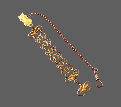 Filigree design bracelet of gold tone. 1920s