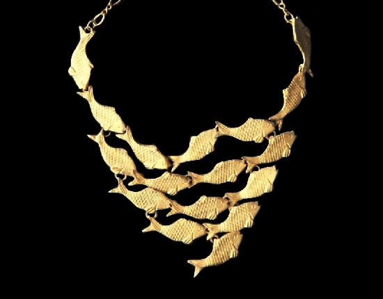Fish necklace of gold tone textured metal