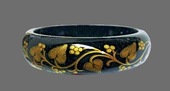 Floral design vintage bangle bracelet. Black and gold lacquer