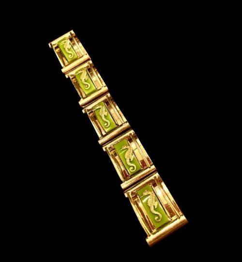 Gold tone seahorse on galalith design bracelet. 1930s